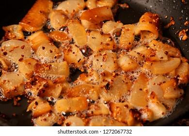 Fried lard with chopped garlic in black iron pan