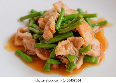 Fried lentil with oyster sauce and pork
