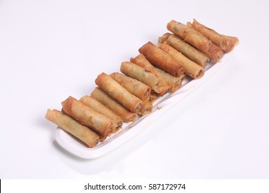 Fried Lumpiang Shanghai or Spring Roll is Filipino Chinese Fusion food made-up of ground pork or beef, minced onion, carrots, and spices with the mixture held together by beaten egg