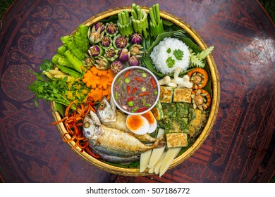 Fried mackerel with chili shrimp paste sauce and vegetable set. Thai food.