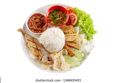 Fried mackerel fish rice with sambal, popular traditional Malay or Indonesian local food. Isolated on white background. Flat lay top down overhead view.