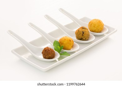 Fried meat balls with ment in a white plate on white background