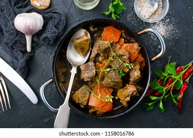 fried meat with carrot and onion, meat with vegetables