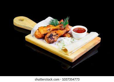 fried meat on black background