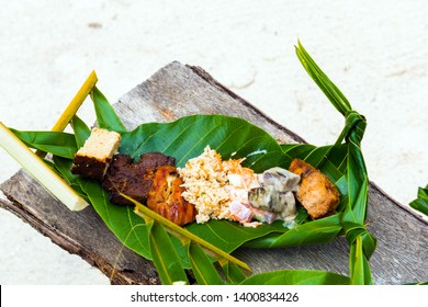Fried meat with rice on a banana leaf, Bora Bora, French Polynesia. With selective focus