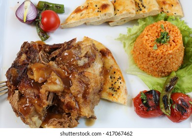 Fried meat with rice and vegetables