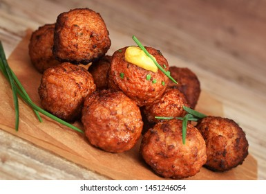 Fried meatball closed up on wooden table