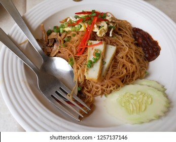 Fried Mee Hoon with sambal on the whiye plate. Top view and close up