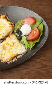 fried mozzarella with grilled vegetableson wooden table