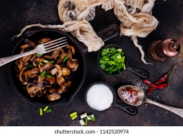 Fried mushrooms and onion in the frying pan.