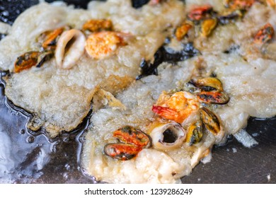 fried mussel octopus and shrimp with flour