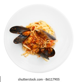 Fried mussels with pasta and tomato sauce in plate isolated on white background