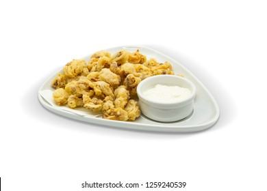 Fried Mussels with Sesame Sauce, White Background, with clipping path included (TR: Midye Tava Tarator Soslu)