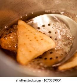 Fried nachos in oil