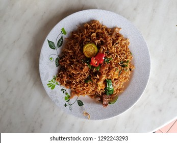 """fried noodle know as """" mee kolok goreng """" by Sarawakian in Malaysia."""