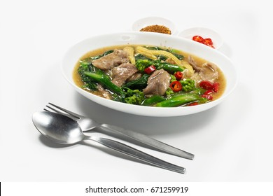 "Fried noodle with pork and kale soaked in gravy on white background. ""Rad Na"" , Thai food."