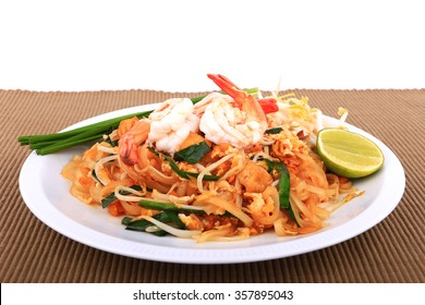 Fried noodle Thai style with prawns, Stir fry noodles with shrimp in padthai style on table. Front view isolate white