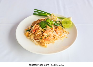 Fried noodle Thai style with prawns, Stir fry noodles with shrimp in padthai style on table.