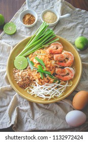 Fried noodle Thai style with shrimp, Fried Rice Sticks with Shrimp, Pad Thai with shrimp on table wood