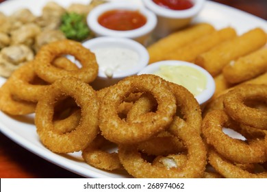 Fried onion rings, fried Mozzarella cheese sticks and fried mushrooms platter