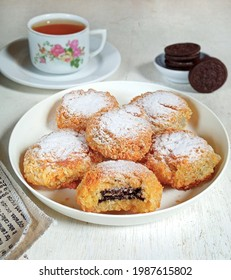 Fried Oreos or Oreo goreng by Indonesians are snacks made from Oreo biscuits dipped in flour mixture and then fried until golden brown and sprinkled with powdered sugar on top.