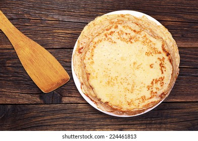 Fried pancakes on old wooden table. Top view