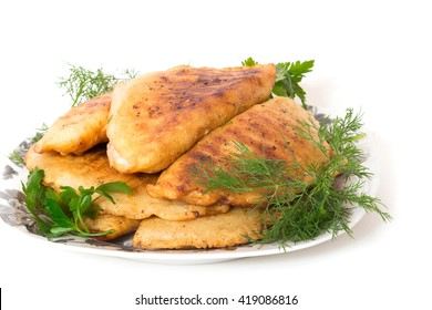 Fried pasties with herbs in a dish on a white background