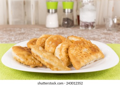 fried pasties on the plate closeup
