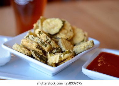 Fried pickle chips with sauce