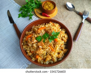 Fried pilaf with veal, carrots and onions
