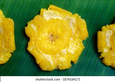 Fried plantain chips on a green leaf