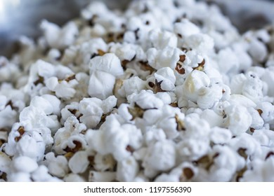 Fried and popped blue popcorn seeds type with very white cold color.