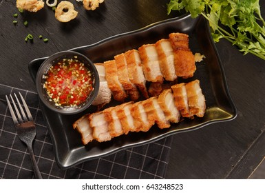 fried pork belly on wood table.  top view