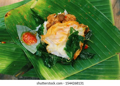 """Fried pork with chili and crispy holy basil. Famous Thai street food serve with fried egg. It's called """"Pad kra prao"""" in Thailand."""