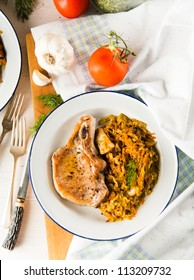 Fried Pork Chop with Bone Served with Sauteed Tomatoes, Cabbage, Potatoes