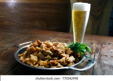 Fried pork crackling with cold beer