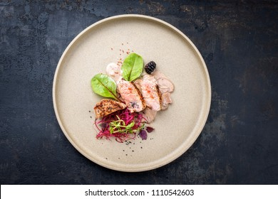 Fried pork fillet with salad and fruits as top view on a plate with copy space