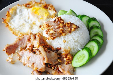 Fried Pork with Garlic and Pepper on Rice with Fried egg