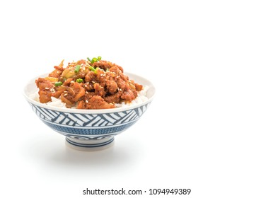fried pork with spicy korean sauce (bulgogi) on top rice isolated on white background