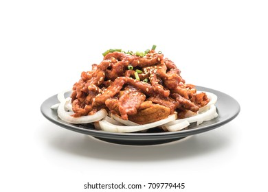 fried pork with spicy korean sauce (bulgogi) isolated on white background