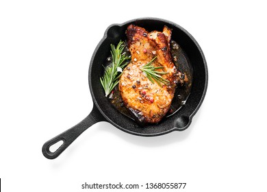 Fried pork steak in frying pan  isolated on white background.