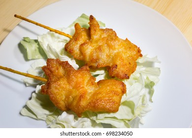 Fried pork with a stick,Grilled pork on a plate