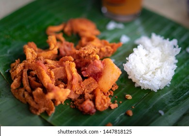 Fried pork with sticky rice ready to eat.