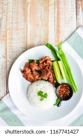 fried pork and thai spicy sauce serve with rice