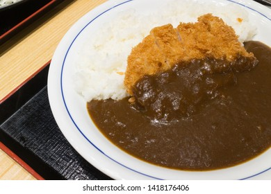 Fried pork Tonkatsu with curry on rice and white dish