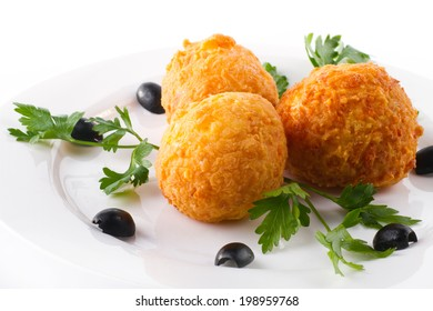 fried potato balls (croquettes) with parsley