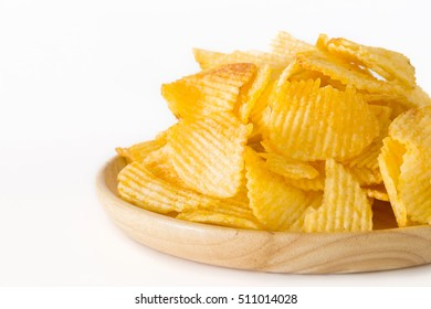 Fried potato chips isolated on white background.