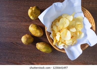 Fried potato chips and raw potato