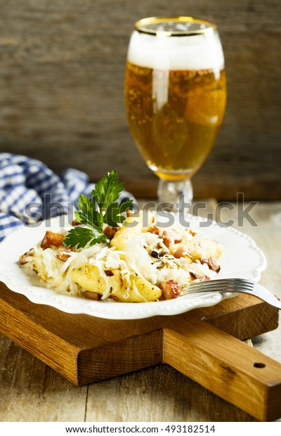 Fried potato gnocchi with ham and cabbage