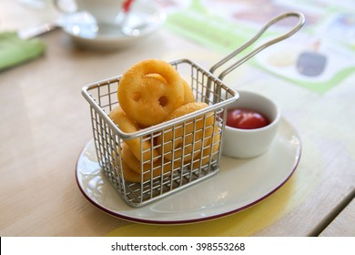 """A fried potato in shape of """"smile"""" with ketchup on table in cafe"""